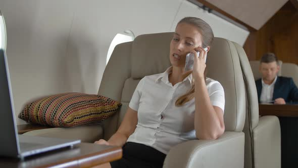 Private Jet Flight of Businesslady Speaking About Business
