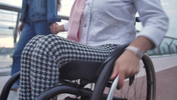 Adult Woman in Wheelchair and Her Daughter on Walk
