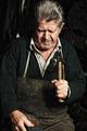 Old man, shoemaker, repairing old handmade shoe in his workshop - PhotoDune Item for Sale
