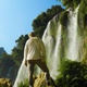 4K Back of Young Woman in Front of Waterfall in the Mountains of Vietnam - VideoHive Item for Sale