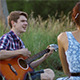 Guy Playing Guitar For His Girlfriend - VideoHive Item for Sale