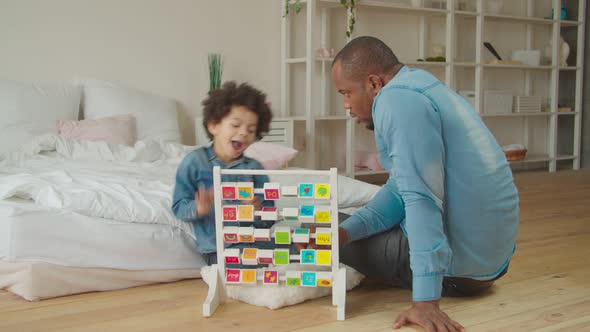 Dad Teaching Son Alphabet with Educational Abc Toy