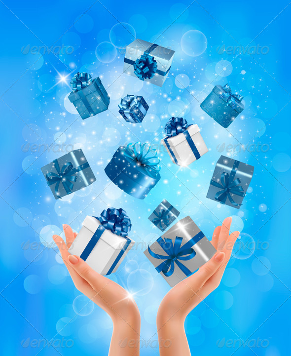 Holiday Background with Hands holding Gift Boxes.