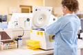 Scientist Using PCR Machine In Laboratory - PhotoDune Item for Sale
