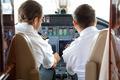 Pilot And Copilot In Private Jet Cockpit - PhotoDune Item for Sale
