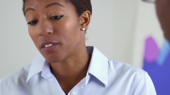 Black Business woman talking to coworker
