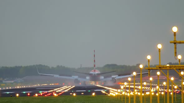 Airliner Landing on the Runway After Landing in a Rainy Weather