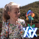 Little Girl With Pinwheel - VideoHive Item for Sale