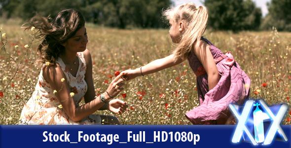 Little Girl Giving A Flower