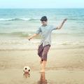 Boy on the beach kiking the football - PhotoDune Item for Sale