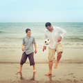 Father and son having fun on the beach with a ball - PhotoDune Item for Sale