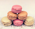 Colorful fresh delicious macaroons on vintage wooden background - PhotoDune Item for Sale
