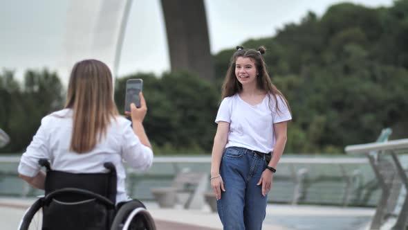 Mom on Wheelchair Shooting Video of Dancing Girl