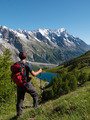 Hiker admiring mountain landscape in Val Veny, Mont Blanc, Courmayer, Italy, Europe. - PhotoDune Item for Sale