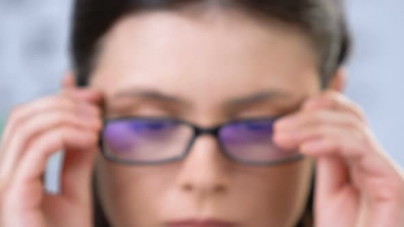 Sad Woman With Vision Disorder Fitting Eyeglasses, Health Problems, Insecurity