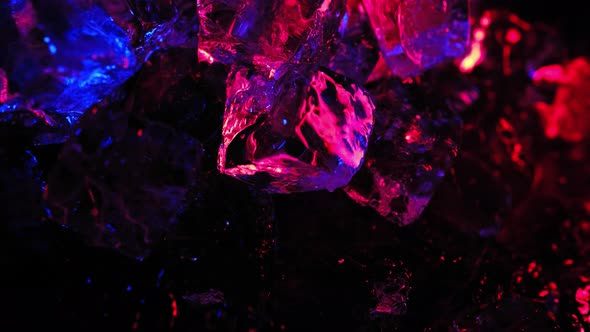 Block Ice is Lit with Neon Blue and Pink in the Light