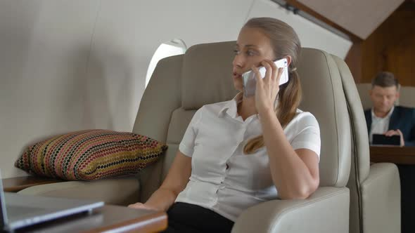 Private Jet Flight of Businesswoman Speaking About Business