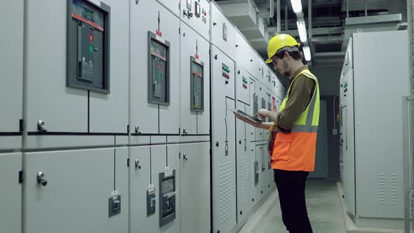 Electrical and Instrument technician checking electrical control board
