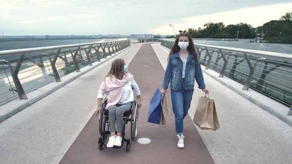 Masked Woman and Girl Walking After Shopping