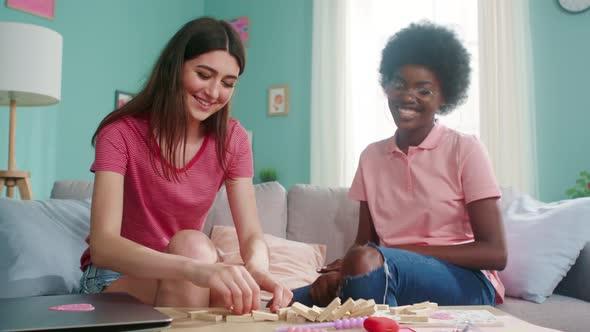 Women Have Fun Playing Board Game