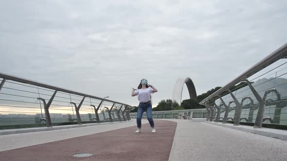 Masked Teen Girl Performing Active Dance Outdoor