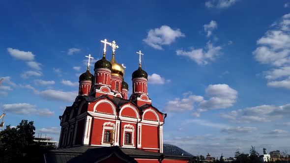 Old Christian Orthodox Church on the Background of Clouds