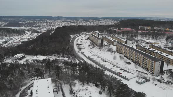 Apartment Buildings on a Hill Winter Time Aerial Reveal