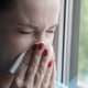 Woman Sneezing Into A Napkin Standing By The Window - VideoHive Item for Sale