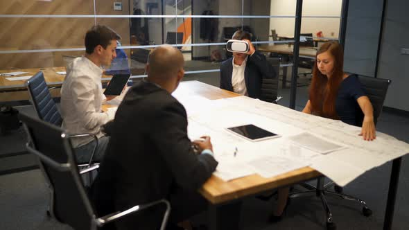 Elegant Man As an Architect Imagining Architectural Project with Virtual Reality Glasses with